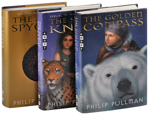 HIS DARK MATERIALS TRILOGY: THE GOLDEN COMPASS, THE SUBTLE KNIFE, AND THE AMBER SPYGLASS. Philip Pullman.
