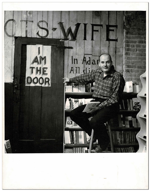 ORIGINAL PHOTOGRAPH OF LAWRENCE FERLINGHETTI IN THE BASEMENT OF CITY LIGHTS BOOKSTORE. William J. Eisenlord.