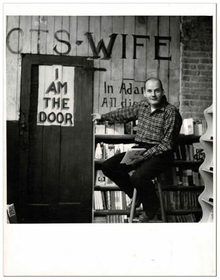 ORIGINAL PHOTOGRAPH OF LAWRENCE FERLINGHETTI IN THE BASEMENT OF CITY LIGHTS BOOKSTORE. William J....